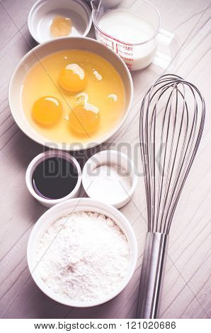 Ingredients for baking cake in bowls, egg, flour