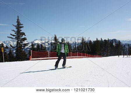 Young Snowboard Man Sliding Downhill.