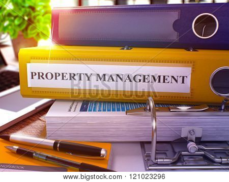 Yellow Ring Binder with Inscription Property Management.