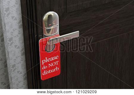 Don Not Disturb Sign Hanging on Room Door in a Fancy Hotel