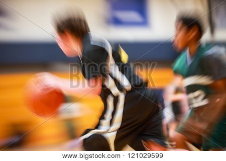 Youth basketball motion blurred image