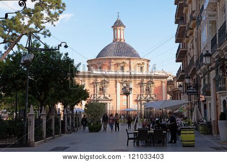 VALENCIA, SPAIN - NOV 5, 2015: Tourists enjoy the area near the Plaza de la Virgene.