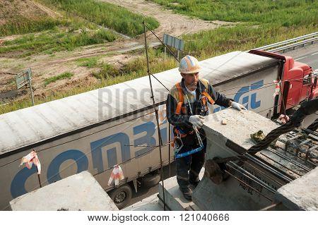Worker mouning bridge span