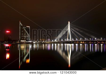 The night scene of the Vansu bridge over river Daugava Riga Latvia. poster