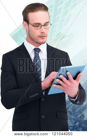 Unsmiling businessman using tablet pc against new york street