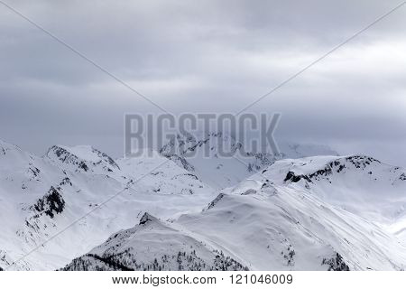 Snowy Mountains In Fog At Gray Morning