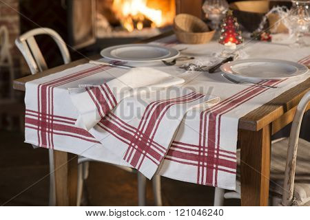 Tablecloth Of Red Stripe Design And Dinnerware Arranged For Meal