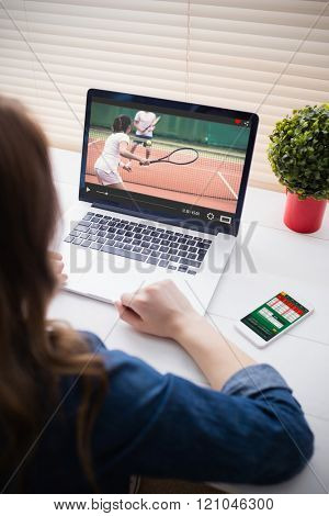 View of lecture app against businesswoman typing on laptop keyboard