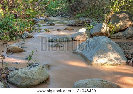 Landscape view of Santa Paula Creek with running water. poster