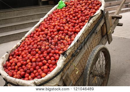 Hand cart full of plums