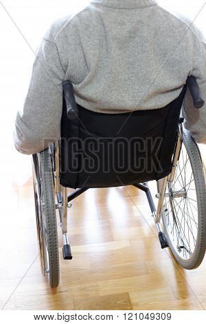 Disabled Elderly In A Wheelchair In The Room