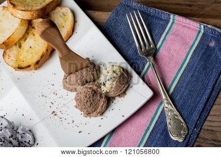 Tasty Appetizers With Chicken Liver Pate, Valerian Salad, Toasted Bread And Blueberry Mousse