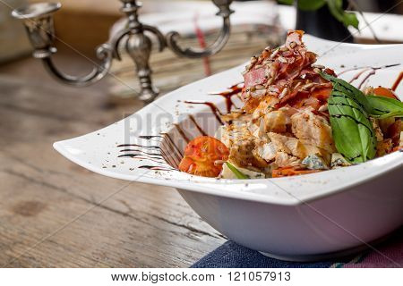 Tasty Grilled Chicken Salad With Rucola, Cherry Tomatoes, Valerian, Basil, Seeds, Bread Crumbs On An