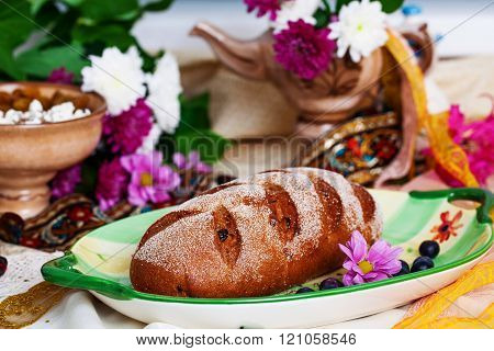 Beautiful Czech nat on loaf in a still life with flowers and ribbons