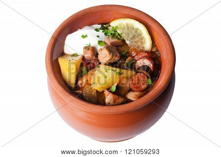 halophyte with sausages lemon and sour cream in a pot on a white background izoirovanno to menu