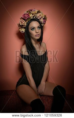 Hairstyle and Make up - beautiful female art portrait with wreath of roses, studio. Elegance