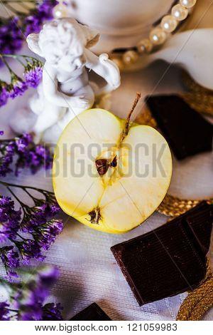 half an apple in a beautiful still life angel figurine