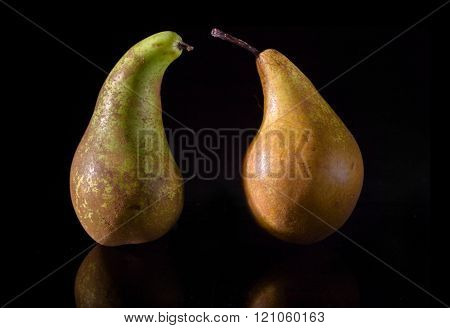 Two Pears On A Black Background
