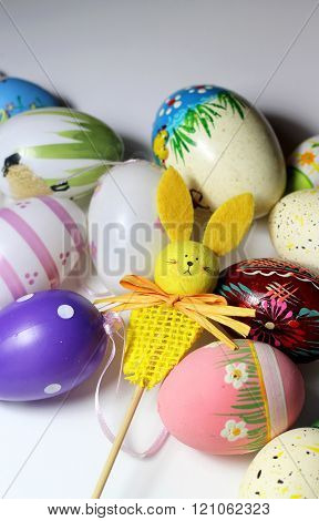 Mix of multicolored painted vivid Easer eggs and rabbit poster