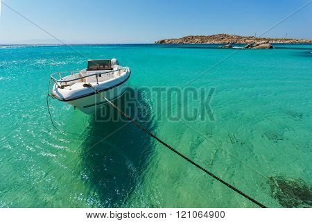 Small boat in Paranga Beach on the island of Mykonos, Greece