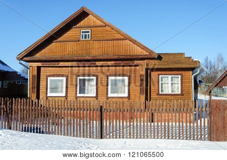 Old Brown Wooden House In Winter Time
