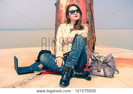 Thoughtful Young Woman Relaxing After Laptop Work Back Sitting To Old Lighthouse - Businesswoman