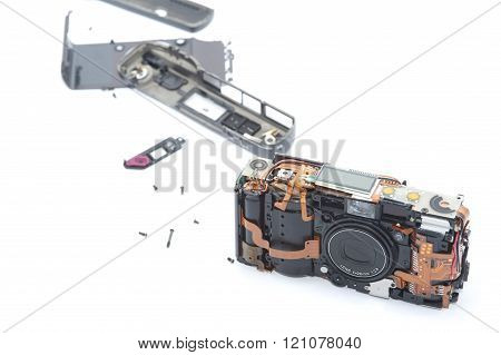 Exploded Camera Laying On White Background