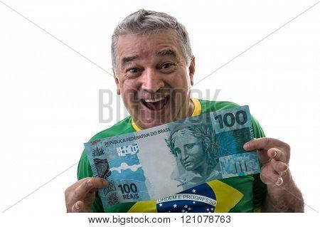Happy Brazilian man showing reais (Brazilian money) on white background