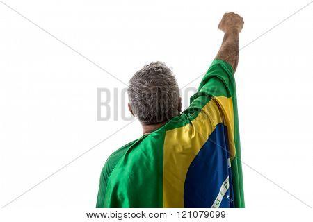 Brazilian man holding the flag of Brazil on white background