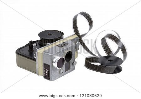 The old Soviet film camera with a 16mm motion picture film on a white background