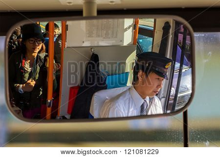 MIE JAPAN - NOVEMBER 20 2015: A Japanese bus driver's on the way to Ise-jingu shrine in Ise city