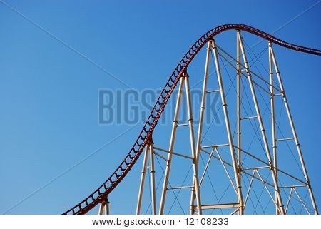 rollercoaster frame against blue sky