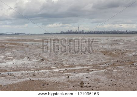 Panoramic View Of Auckland's City Background In Dark Rainy Cloudy Sky.