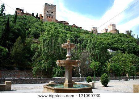 Stone fountain along Paseo de los Tristes, Granada.