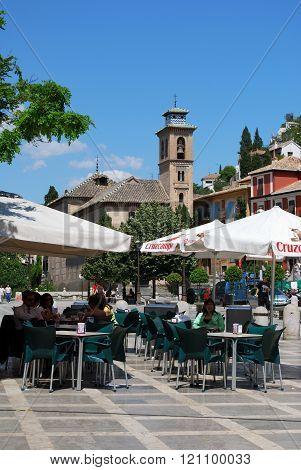 Pavement cafe and church, Granada.