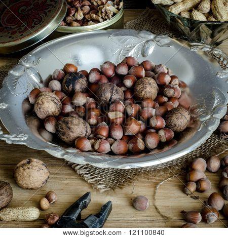 Hazelnuts, peanuts, walnuts on a wooden table