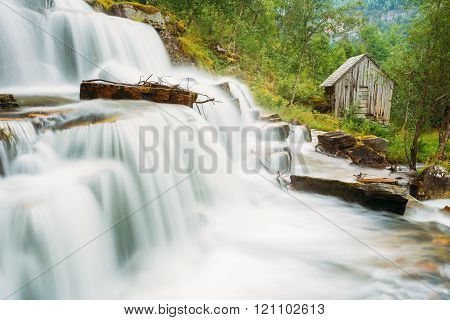 Beautiful famous Tvindefossen Waterfall in Norway
