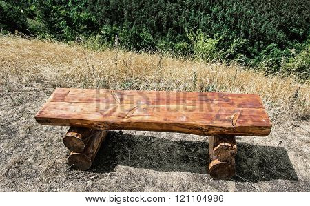Wooden bench serving to rest during the hiking