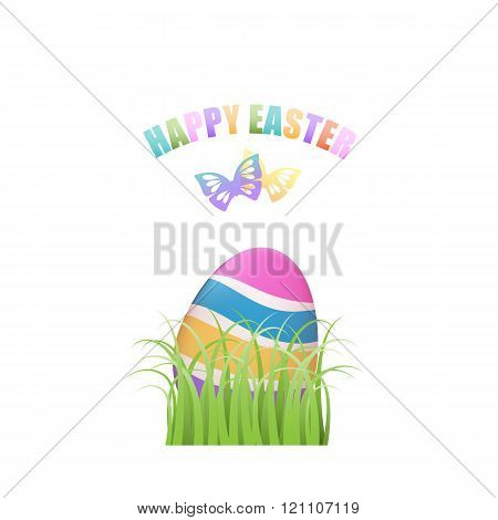 Colorful Easter egg in green grass with butterflies