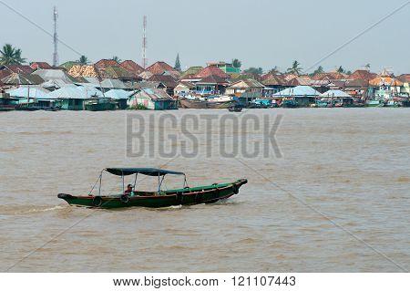 Boat on Musi River July 30, 2011 in Palembang, Sumatra, Indonesia.