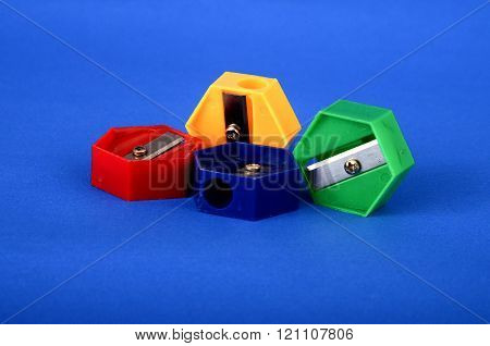 Pictureof a Colour pencil sharpeners on blue