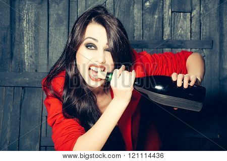 Woman Opening Wine Bottle