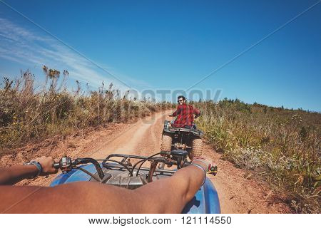 Young Man Driving All Terrain Vehicle In Nature