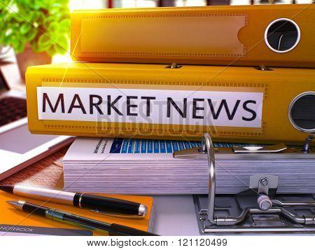 Market News on Yellow Office Folder. Toned Image.