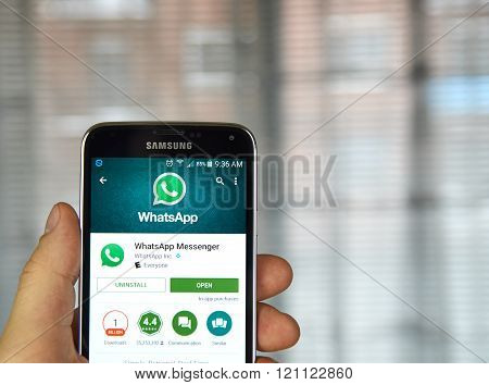 MONTREAL CANADA - MARCH 8 2016 - Whatsapp mobile application on screen of Samsung S5 in hand.