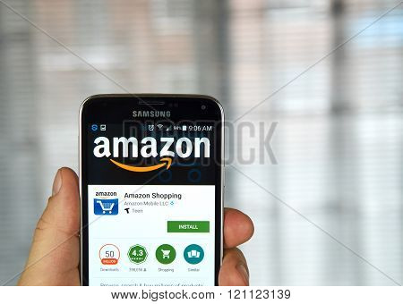 MONTREAL CANADA - MARCH 8 2016 - Amazon mobile application on screen of Samsung S5 in hand.