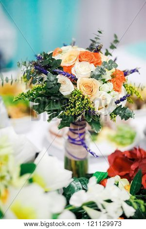 Wedding bouquet on a table at banquet.