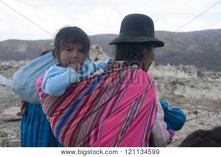 ISLA DEL SOL, BOLIVIA - NOVEMBER 2008 : A family walks home after a hard day's work . November 2008 in Isla del Sol, Bolivia .