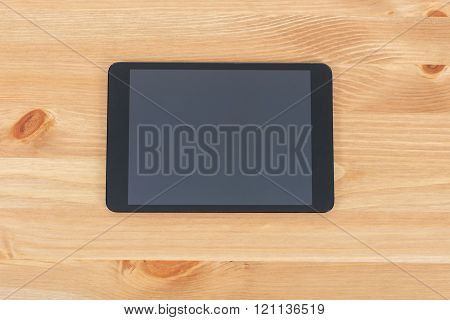 Workplace With Tablet On A Wooden Work Table