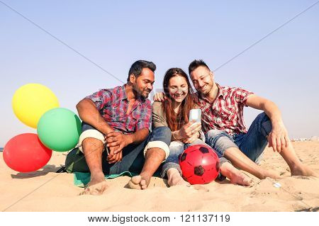 Cheerful Multiracial Group Of Friends Taking Selfie On The Beach - Couple And Indian Race Guy